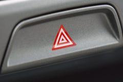 Detalhe de um botão de advertência em um carro Imagem de Stock