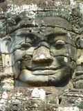 Detalhe de um rosto humano no templo de Bayon em Camboja Fotografia de Stock Royalty Free