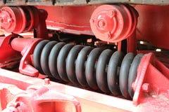 Detalhe de um trator vermelho velho imagens de stock royalty free