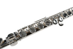 Detalhe de uma flauta de prata no branco Fotografia de Stock Royalty Free