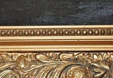 Detalhe do close up de quadro antigo do ouro de bronze velho Fotos de Stock