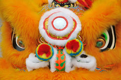 Detalhe do leão da propriedade na dança chinesa do leão Fotografia de Stock Royalty Free