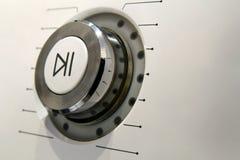Detalhe do macro do botão do poder do jogo e da pausa Foto de Stock Royalty Free