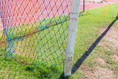 Detalhe do objetivo do futebol com um futebol Imagens de Stock Royalty Free