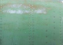 Detalhe pintado velho de um avião militar, corrosão de superfície do fundo do metal imagem de stock royalty free