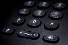 Detalhe preto do teclado numérico do telefone imagens de stock