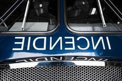 Detalhes azuis do Firetruck da parte dianteira com fraseio Imagem de Stock