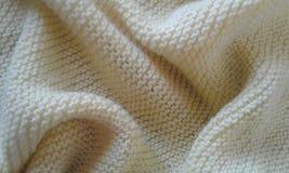 Detalhes da textura do tecido do amarelo de lãs de pano fotos de stock