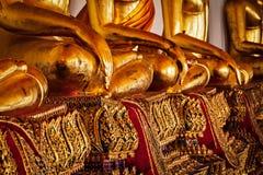 Detalhes de assento das estátuas da Buda, Tailândia Fotografia de Stock