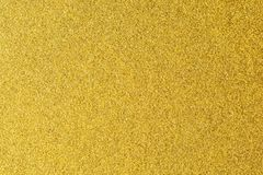 Detalhes de fundo dourado da textura Parede da pintura da cor do ouro Fundo e papel de parede dourados luxuosos Folha de ouro ou Imagens de Stock