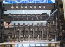 Detalhes de peças sobresselentes da máquina de impressão na tipografia imagens de stock