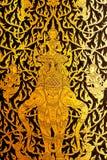 Detalhes de pintura tailandesa da porta do estilo tradicional. Foto de Stock Royalty Free