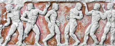 Detalhes romanos do Bas-relevo e da escultura na pedra Imagem de Stock