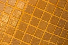 Detalj av brun bakgrund för tegelplattaväggtextur royaltyfri bild