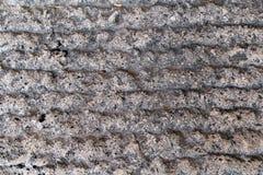 Detalj av den gamla medeltida trottoar-/kvarterstenvägen/bruten stentrottoar/tappningbakgrund Royaltyfria Bilder