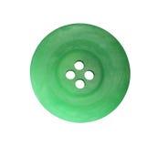 Detalj av den gröna knappen på vit bakgrund arkivfoton
