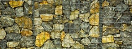 Detalj av den skyddande väggen som göras av stenar arkivfoton
