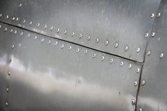 Detalj av det gamla grungestycket av flygplan arkivbilder