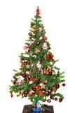 Detalj av det gröna trädet för jul (Chrismas) med kulöra prydnader, jordklot, stjärnor, Santa Claus, snögubbe arkivbilder
