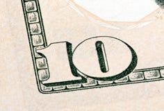 Detalj av 10 dollar sedel som isoleras på vit bakgrund Stac Royaltyfri Bild