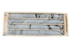 Detalj av drillborrkärnan i askarna som är klara för att logga Arkivfoto