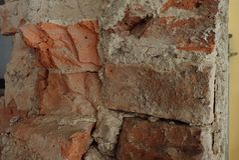 Detalj av en gammal tegelstenvägg arkivfoto