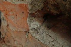 Detalj av en gammal tegelstenvägg arkivfoton