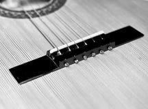Detalj av en gitarr Arkivfoto