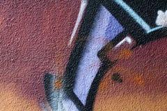 Detalj av en grafittikonst på en vägg Arkivfoton