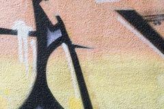 Detalj av en grafittikonst på en vägg Arkivbild