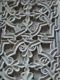Detalj av en sten som inristas i stenen av ett khachkar i Armenien arkivfoton