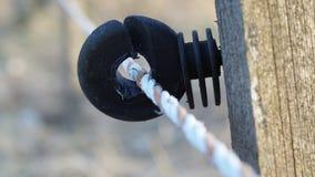 Detalj av ett elektriskt staket Arkivbild