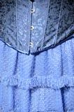 Detalj av förklädnadkläder arkivfoto