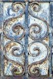 Detalj av ironworken på en gammal dörr Royaltyfri Foto