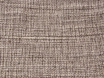 Detalj av ohyfsat bomullstyg i neutrala färger Arkivfoto