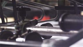 Detalj av papper för transportörer för printingmaskiner arkivfilmer