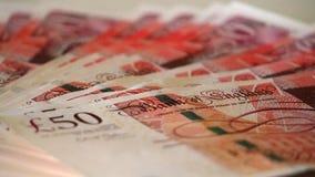 Detalj av 50 pund sedlar med framsidan av drottningen av Förenadet kungariket Royaltyfria Bilder