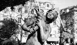 Detalj av statyn på den Restauradores fyrkanten Royaltyfri Bild