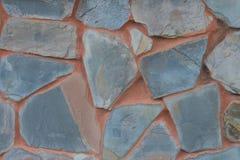 Detalj av stenv?ggen som g?ras av den klippta stenen arkivbild