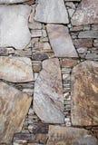 Detalj för stenvägg av en sida av en byggnad med unika särdrag Arkivfoto