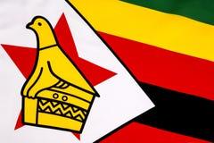 Detalj på flaggan av Zimbabwe Arkivfoto