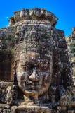 Detalj som ler framsidan i den Bayon templet Royaltyfria Bilder