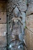Detaljen av apsaradansare sned på det Angkor Wat komplexet i Cambodja Royaltyfria Bilder