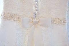 Detaljer av bröllopsklänningen Royaltyfri Foto