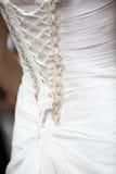 Detaljer av bröllopsklänningen royaltyfri bild