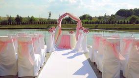 Detaljer av garnering för utomhus- bröllopceremoni arkivfilmer
