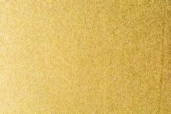 Detaljer av guld- texturbakgrund Guld- färgmålarfärgvägg Lyxig guld- bakgrund och tapet Guld- folie eller Royaltyfria Bilder