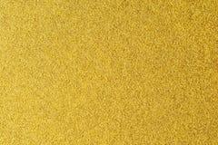 Detaljer av guld- texturbakgrund Guld- färgmålarfärgvägg Lyxig guld- bakgrund och tapet Guld- folie eller arkivbilder