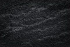 Detaljer som naturen av mörk svart kritiserar med den gråa stenen i våg, formade modeller många lager eller bakgrund royaltyfri foto