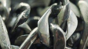 Detalle ascendente cercano de la cadena del metal Fondo con el espacio de la copia fotografía de archivo